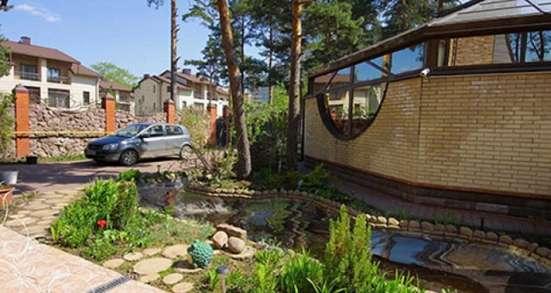 Дом с участком в Приморском районе