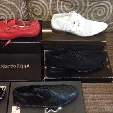 Продам новую фирменную обувь