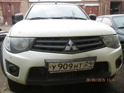 автомобиль Mitsubishi L200